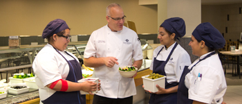 Chef Kevin Aiello instructing Dining Services team members